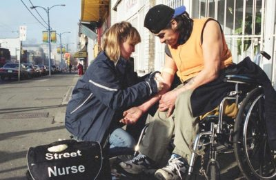 Street nurse attends to a patient